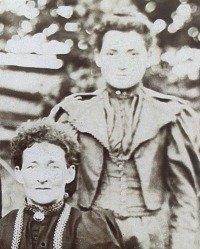Mary Ann Marcy stands behind her mother Sarah (formerly McNeilly) in this June 1896 family portrait.